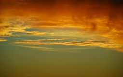Sunset copper yellow gold. Stunning sunset with copper, gold, yellow clouds royalty free stock photo