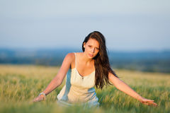 Sunset corn field beautiful brunette woman walk Stock Image