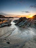 Sunset on a Cornish Beach. Sunset at Lusty Glaze beach at Newquay in Cornwall stock photo