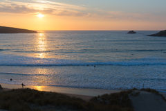 Sunset in Cornwall surfers surfing Crantock bay and beach North Cornwall England UK near Newquay Royalty Free Stock Photography