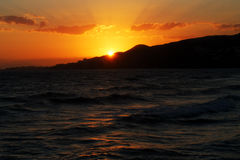 Sunset at Costa del Sol. Sunset near Nerja at the Costa del Sol. Waves come rolling onto the beach as tranquility sets in after the day's vibrant beach life stock photos