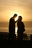 Sunset couple. Hand in her head Stock Photo