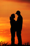 Sunset couples. A young couple in a beautiful sunset where hugged Stock Photos
