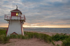 Sunset at Covehead. A dramatic sunset with colourful clouds behind the Covehead Lighthouse in Stanhope, PEI Stock Image