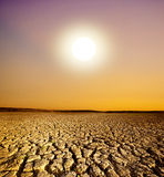 Sunset and The Cracked Land Royalty Free Stock Photography