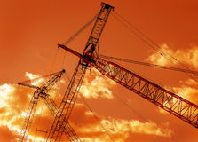 Sunset Crane Booms at Rest Stock Photography