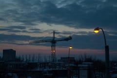 Sunset Through A Crane In The Night Stock Photos