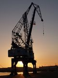 Sunset cranes v. Cranes at vigo's port Royalty Free Stock Photography