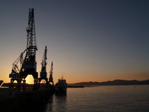 Sunset cranes vi. Cranes at vigo's port stock image