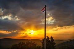 Sunset with Croatia flag on flagpole Royalty Free Stock Photo
