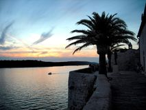 Sunset on Croatia. This photo was taken on an island in Croatia and portrays a sunset seen from a village perched on the sea, in the image with the sunset in the Royalty Free Stock Images