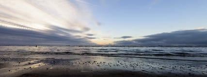 Sunset on Crosby Beach in winter - panorama, Crosby, Liverpool, UK Stock Image