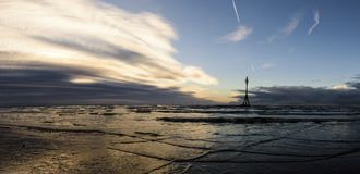 Sunset on Crosby Beach in winter - panorama, Crosby, Liverpool, UK. Sunset on Crosby Beach in winter - panorama, Crosby, Liverpool, United Kingdom Stock Image