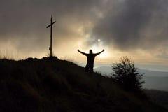 Sunset cross hill top Stock Image