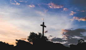 Sunset cross. The silhouette of a cross and a amazing sunset Stock Image