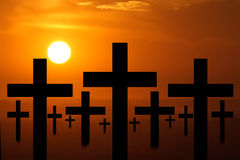 Sunset crosses. Crosses with a sunset behind it Stock Image