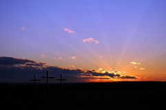 Sunset With Crosses. Colorful sunset with three crosses stock photos