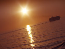 Sunset and cruise ship Royalty Free Stock Image