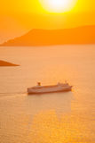 Sunset with a cruise ship in the Aegean sea Stock Images