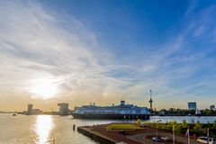 Sunset with a cruise ship navigating a canal stock photo