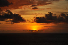 Sunset Cruise. A vibrant orange and golden sunset Stock Photos