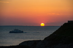 Sunset, Cruiser boat in silhouette, Brittany Royalty Free Stock Photos