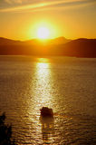 Sunset Cruising. A boat/yacht cruising along with sunset background Royalty Free Stock Images