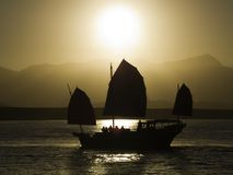 Sunset crusie. An oriental sunset cruise coming back into port stock image