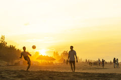 Sunset on Cua Dai Beach. 5h30 pm, team playing kick out up a row Stock Photography