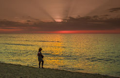 Sunset at cuban beach with tourist Stock Photo