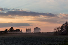 Sunset on cultivated fields Royalty Free Stock Photo