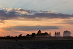 Sunset on cultivated fields Stock Photos