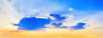 Sunset with cumulus clouds Stock Images