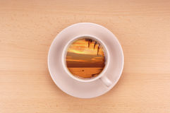 Sunset in a cup of coffee Royalty Free Stock Images