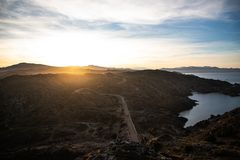 Sunset and a curved road view in Cap de Creus, Catalunya stock photos
