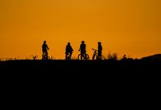 Sunset and cyclist Royalty Free Stock Image