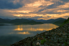 Sunset at the dam. With still water Royalty Free Stock Photo