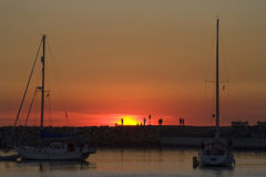 Sunset at Dana Point silhouette of people Royalty Free Stock Image