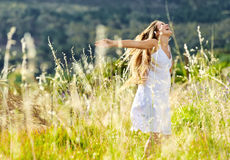 Sunset dancing meadow girl Stock Photos