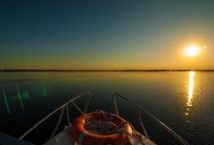 Sunset in the Danube delta Romania.Beautiful blueish lights in water.Beautiful sunset landscape from the Danube Delta Biosphere Re stock photo