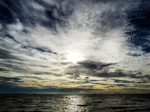 Sunset and dark cloud Stock Images