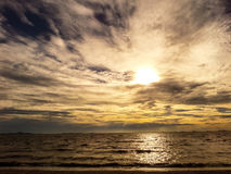 Sunset and dark cloud Royalty Free Stock Image