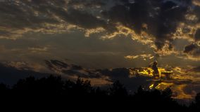 Sunset in dark clouds. With beams of the sun stock video