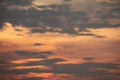 Sunset with dark clouds in thialand.  Royalty Free Stock Photo