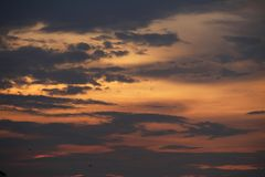 Sunset with dark clouds in thialand.  Stock Image