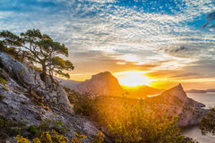 Sunset. Dawn in the Crimea in the mountains by the sea Stock Photos