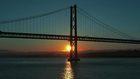 Sunset on the 25 de Abril Bridge in Lisbon. Portugal stock video