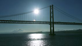 Sunset on the 25 de Abril Bridge in Lisbon. Portugal stock video footage
