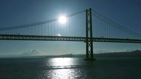 Sunset on the 25 de Abril Bridge in Lisbon stock video footage