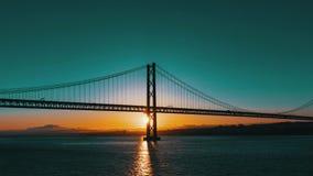 Sunset on the 25 de Abril Bridge in Lisbon stock footage